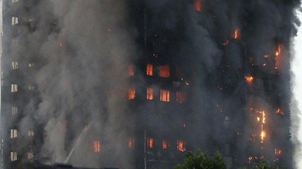 Smoke and flames rise from a building on fire in London on Wednesday.