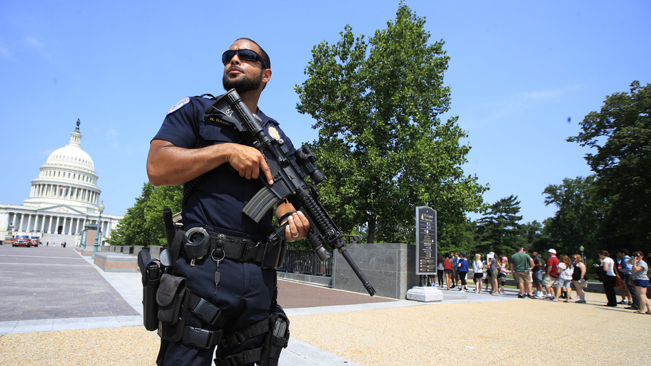 A Capitol Police officer stands guard on Capitol Hill in Washington, D.C., on Wednesday after House Majority Whip Steve Scalise, R-La., was shot during a congressional baseball practice in Alexandria, Va. (Manuel Balce Ceneta/AP)