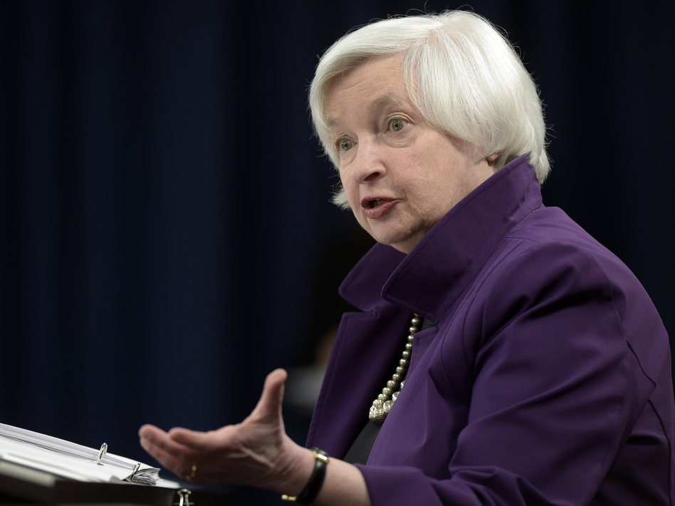 Federal Reserve Chair Janet Yellen speaks to reporters in Washington, D.C., on Wednesday after the Fed announced it would increase interest rates by a quarter-point. (Susan Walsh/AP)