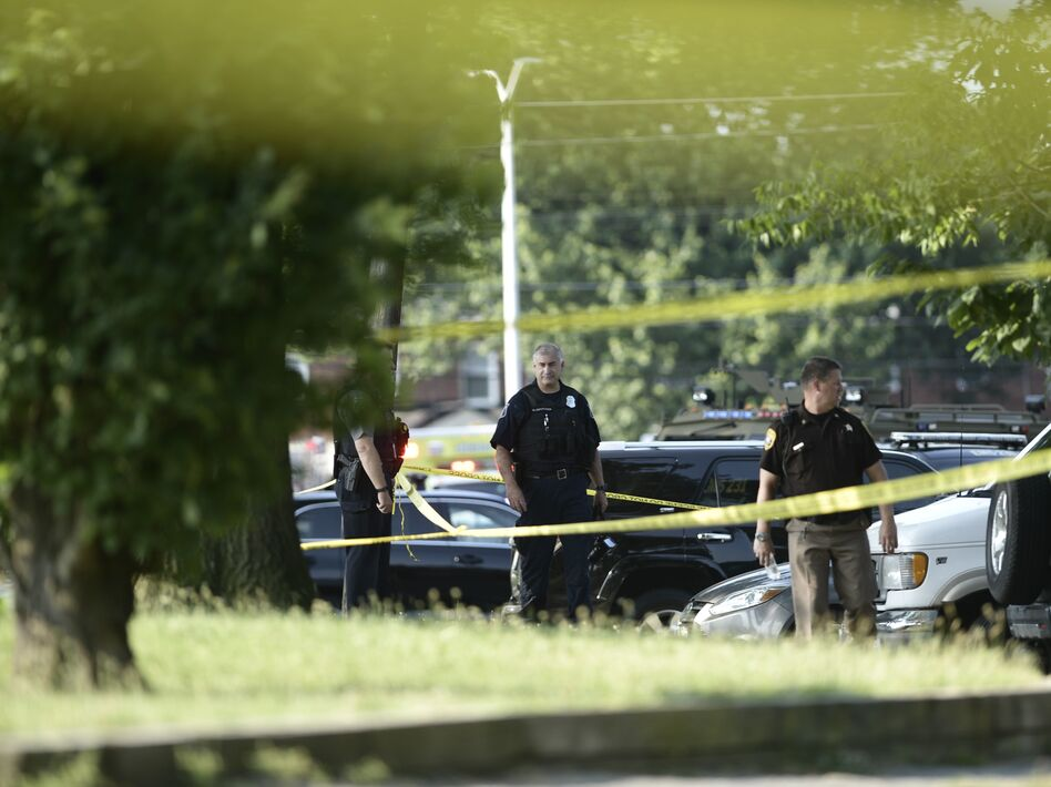 Police tape cordons off the scene of an early morning shooting in Alexandria, Va., June 14. (Brendan Smialowski /AFP/Getty Images)