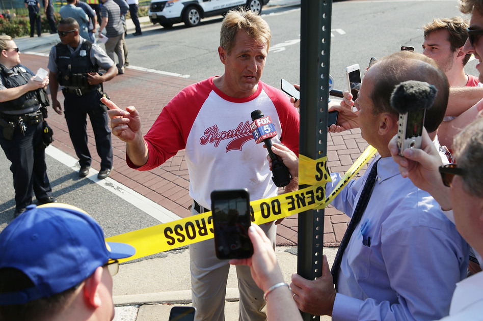 U.S. Sen. Jeff Flake, R-Ariz., briefs members of the media near the shooting site in Alexandria, Va., on Wednesday. U.S. House Majority Whip Steve Scalise, R-La., and several other people were shot during a Republican baseball practice. (Alex Wong/Getty Images)
