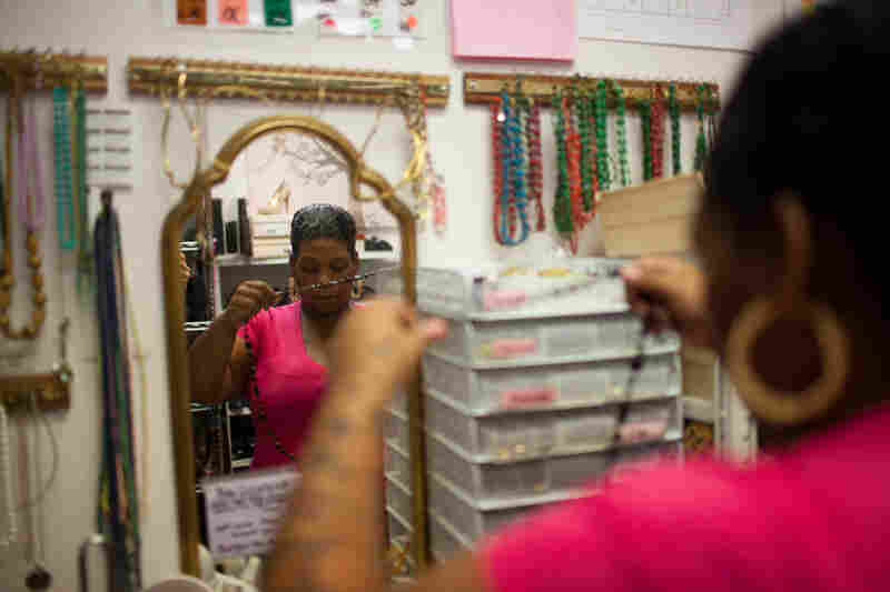 While her daughter and son are at school at Positive Tomorrows, Brenda tries on clothes. A case worker with Positive Tomorrows brought a small group of moms to Suited for Success, a nonprofit in Oklahoma City that gives women outfits for job interviews.