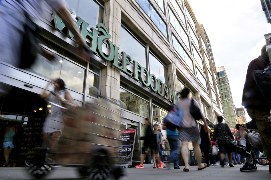"Amazon says Whole Foods stores will continue to operate under their own brand and will continue to source products ""from trusted vendors and partners around the world."" (Julie Jacobson/AP)"