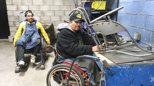 Gabriel Zepeda (right) makes an all-terrain wheelchair. He