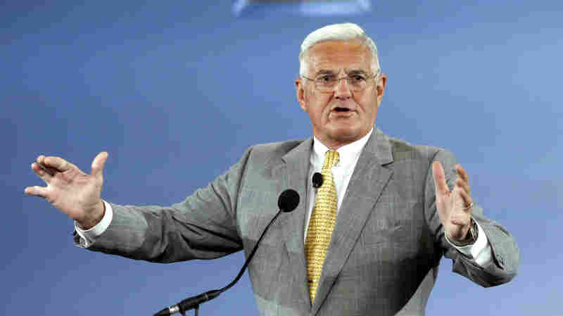 Bob Lutz speaks at the rollout of the Chevrolet Volt hybrid electric vehicle on Nov. 30, 2010, in Detroit, Mich.