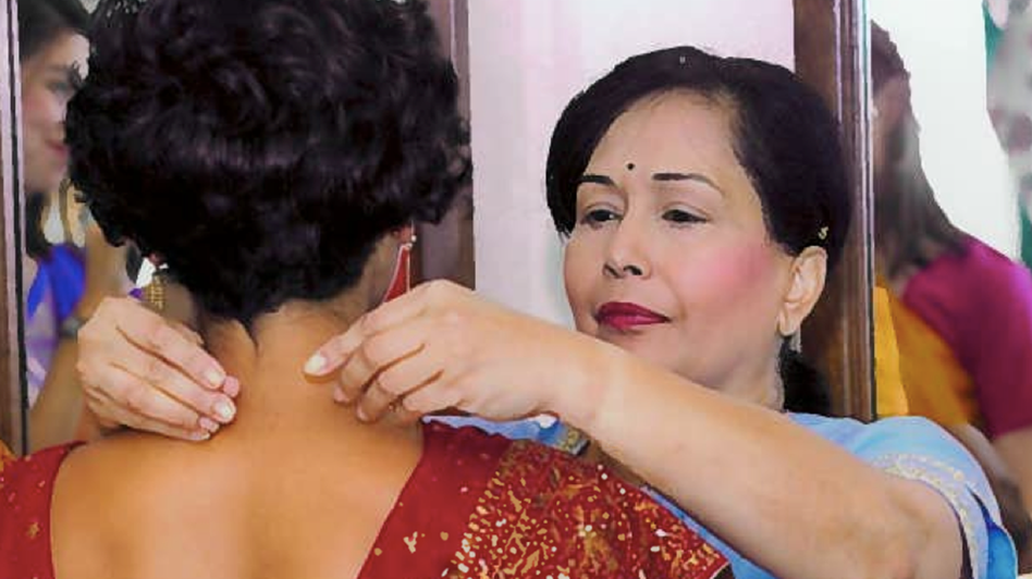 Kamni Vallabh helps her daughter Sonia get ready for her wedding, a few months before Kamni started showing symptoms of the prion disease that would kill her.