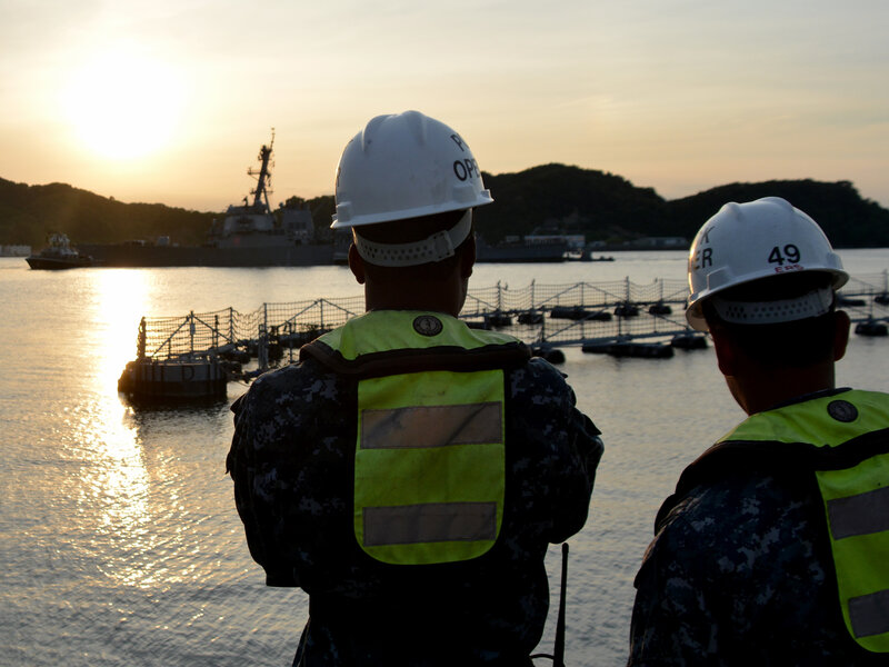 Sailors watch pier-side as the Arleigh Burke-class guided-missile destroyer USS Fitzgerald (DDG 62) returns to Fleet Activities (FLEACT) Yokosuka following a collision with a merchant vessel while operating southwest of Yokosuka, Japan.     (MC1 Peter Burghart/U.S. Navy)
