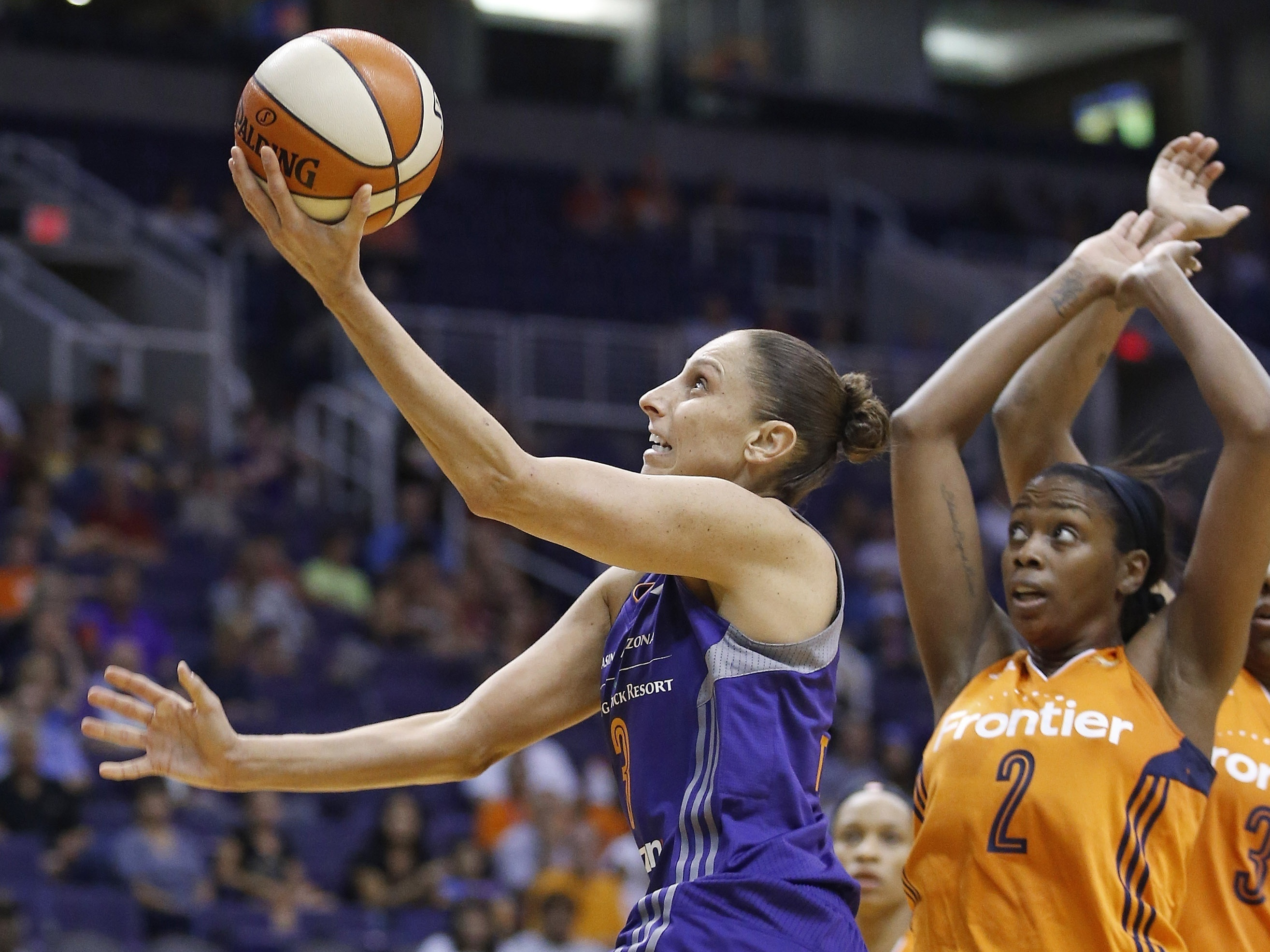 The Phoenix Mercury's Diana Taurasi set the WNBA's all-time scoring record on Sunday. Above Taurasi drives past the Connecticut Sun in a May 2016 game
