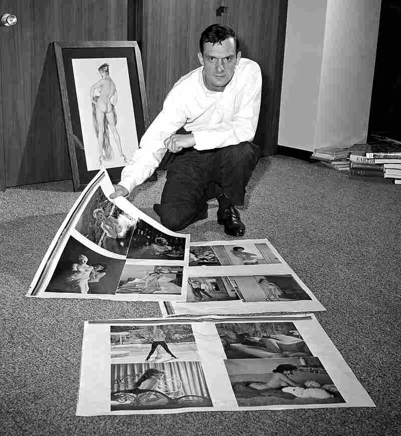 Hefner looks over proof sheets for Playboy in 1961 in Chicago.