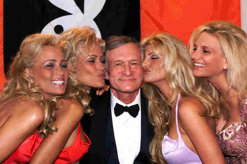 Hefner poses with Playboy playmates at the 1999 Cannes Film Festival in France.