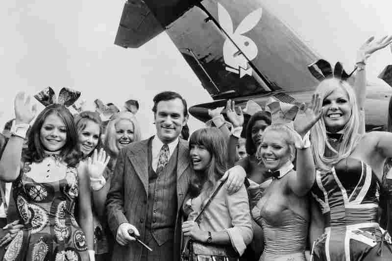 Hugh Hefner and then-girlfriend Barbi Benton arrive at France's Paris-Le Bourget Airport with Playboy playmates in 1970.