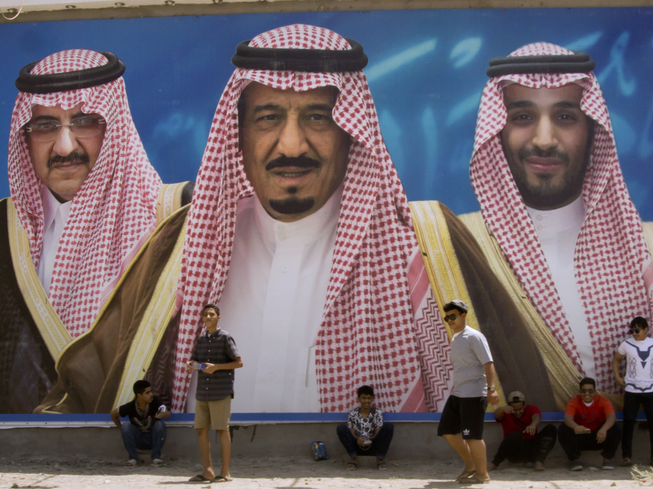 A billboard in Taif, Saudi Arabia, shows King Salman bin Abdul-Aziz Al Saud (center) flanked by his 31-year-old son, Mohammed bin Salman (right), and Prince Mohammed bin Nayef. The king appointed his son as his successor and first in line to the throne, stripping Nayef of the title of crown prince and ousting him from his powerful position of interior minister. (Amr Nabil/AP)