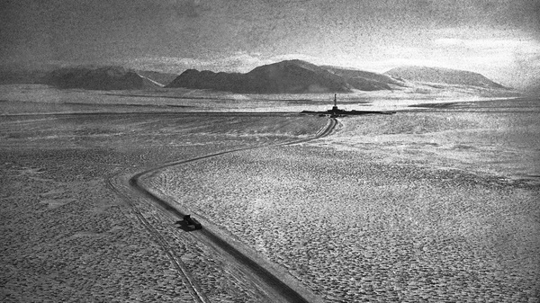An oil derrick stands out on the bitter, icebound terrain near Prudhoe Bay, Alaska, in 1974.