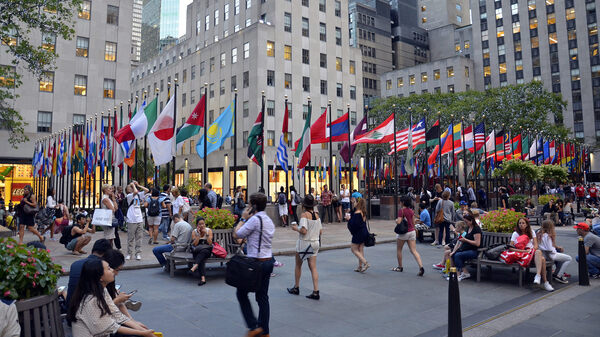 Pedestrians walk through Rockefeller Center in New York City. According to the U.S. Census Bureau, the Asian population recently grew by 3 percent to 21.4 million and people who identified as being of two or more races grew by 3 percent to 8.5 million.