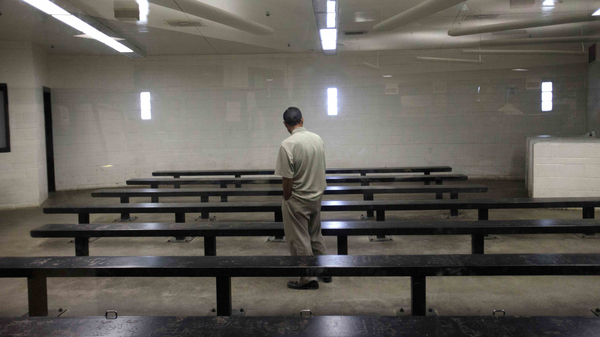 A man waits to be processed at a Border Patrol detention center in Imperial Beach, Calif.