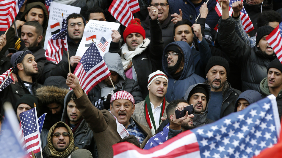 Muslims and supporters gather on the steps of Borough Hall in Brooklyn, N.Y., during a protest against President Trump's temporary travel ban in February. (Kathy Willens/AP)