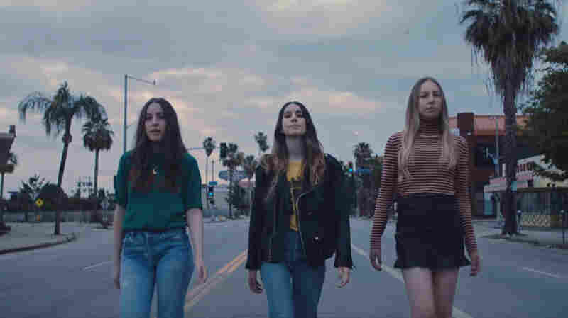 HAIM Walks The Streets Of Its Hometown For 'Want You Back' Video