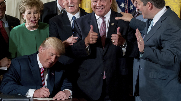 President Trump signs a memo and letter to Congress outlining the principles of his plan to privatize the nation