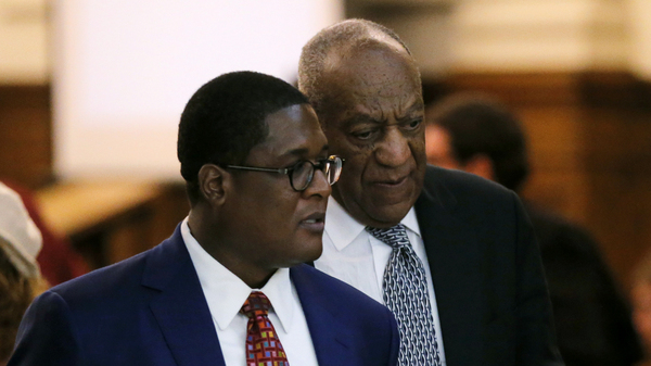 Actor and comedian Bill Cosby (right) walks with spokesperson Andrew Wyatt during deliberations in Cosby