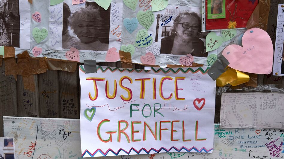 Tributes to victims of the Grenfell Tower fire are left near the building in West London on Friday. Combustible cladding has been found in a number of similar tower blocks in Britain, Prime Minister Theresa May said. (Niklas Halle'n/AFP/Getty Images)