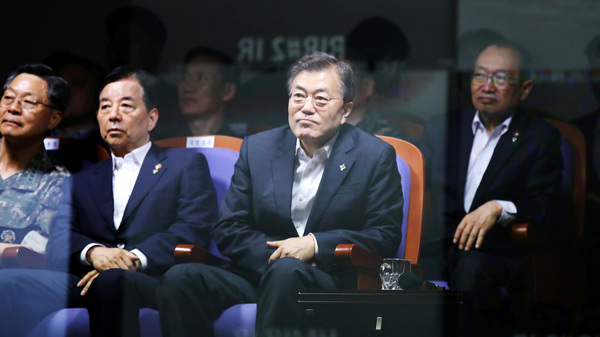 South Korean President Moon Jae-in watches a test-firing of an indigenously developed ballistic missile at the state-run Agency for Defense Development in Taean, South Korea.