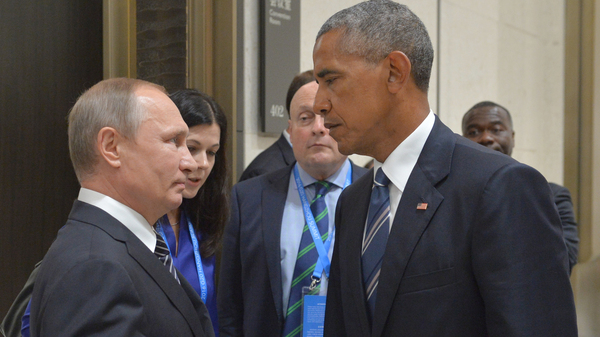 Russian President Vladimir Putin, left, speaks with then- U.S. President Barack Obama in Hangzhou in eastern China