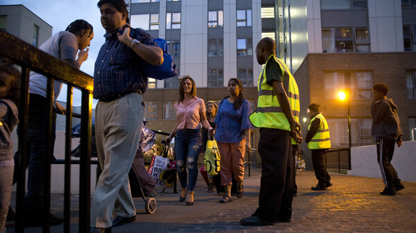 Officials evacuate residents of the Chalcots Estate, in London