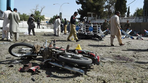 Pakistani security officials inspect the site of an explosion in Quetta on Friday. All told, dozens of people were killed Friday in several different cities across Pakistan.