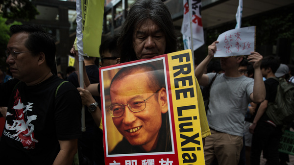 Chinese dissident Liu Xiaobo, whose image is seen here during a pro-democracy protest in Hong Kong last year, has been granted medical parole.