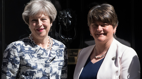 British Prime Minister Theresa May (left) greets Arlene Foster, leader of Northern Ireland