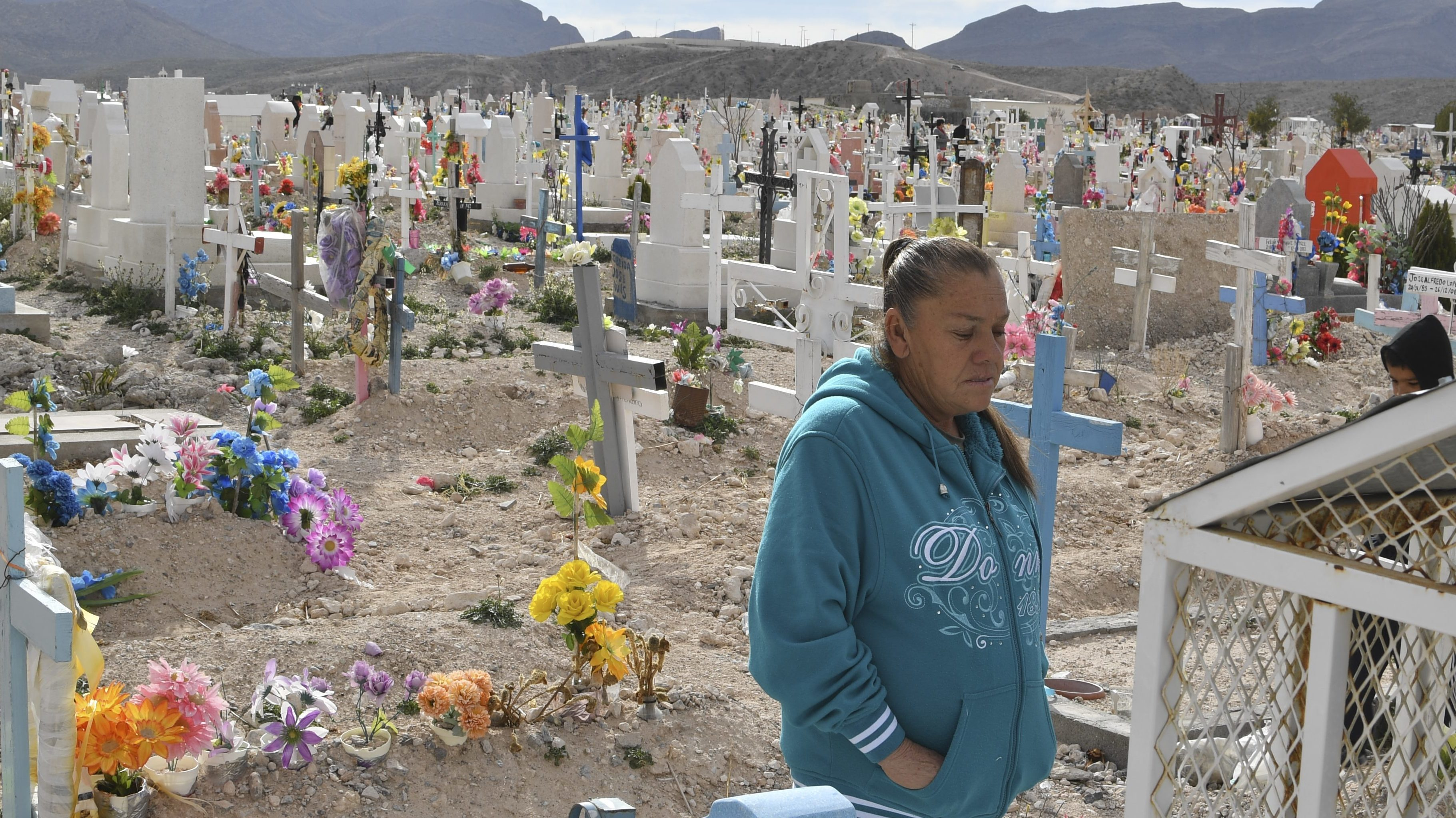 Maria Guereca visiting the grave of her murdered son Sergio Hernandez in February.     (Yuri Cortez/AFP/Getty Images)