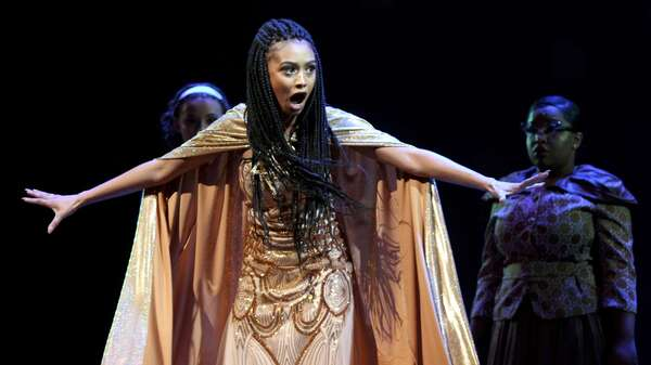Jasmine Rogers performs a number as the Witch from Into the Woods.
