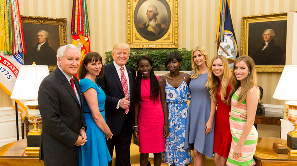 "President Donald Trump and his daughter Ivanka flank Chibok schoolgirls (left to right) Joy Bishara and Lydia Pogu. At far left is Doug Wead, president of the school the girls attend, and his wife, Myriam. Two of his daughters are at the right. This White House ""Photo of the Day"" was taken on June 27."