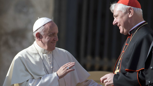Pope Francis talks with Cardinal Gerhard Ludwig Mueller in St. Peter