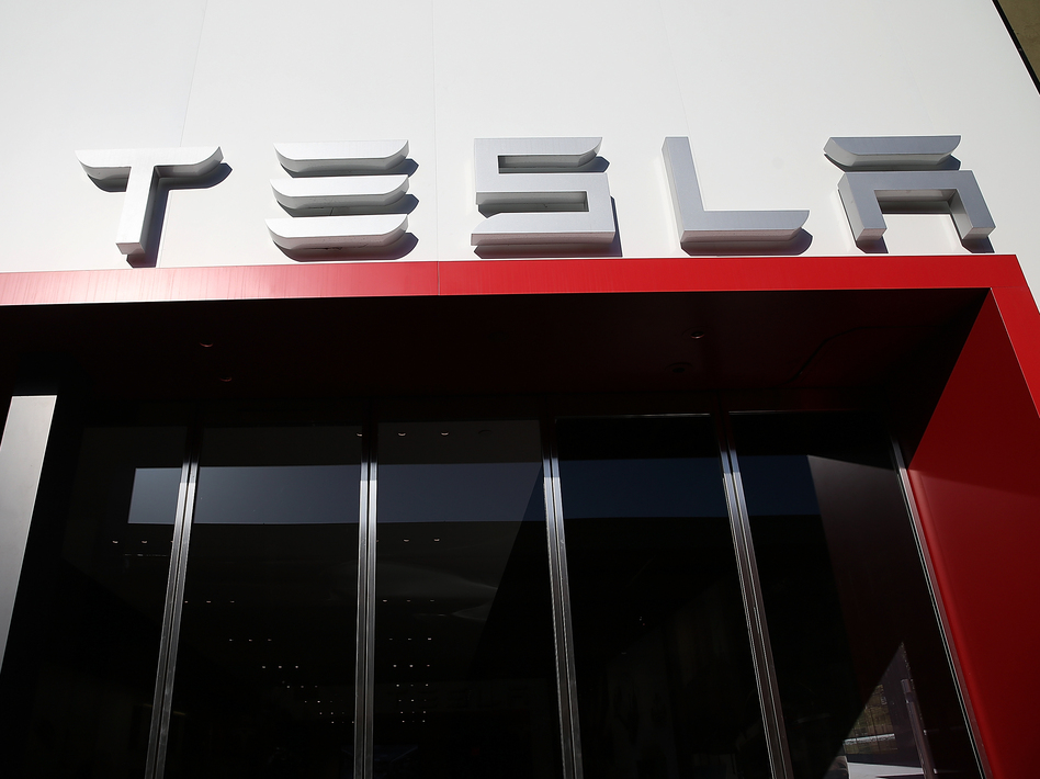 A Tesla showroom in California. The company announced production of its long-awaited mass-market Model 3 car will begin Friday. (Justin Sullivan/Getty Images)