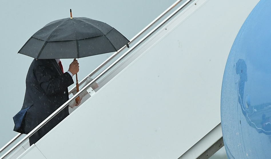 President Trump boards Air Force One before departing from Morristown Municipal Airport in New Jersey over the weekend. Trump is meeting with Russian President Vladimir Putin, among other heads of state, at the G-20 summit. (Mandel Ngan/AFP/Getty Images)