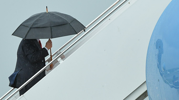 President Trump boards Air Force One before departing from Morristown Municipal Airport in Morristown, N.J., on July 1. Trump is meeting with Russian President Vladimir Putin, among other heads of state, at the G-20 summit.