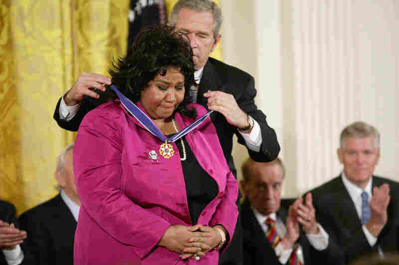 George W. Bush awards Franklin the Presidential Medal of Freedom at the White House in 2005.