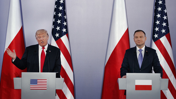 President Trump speaks during a news conference with Poland