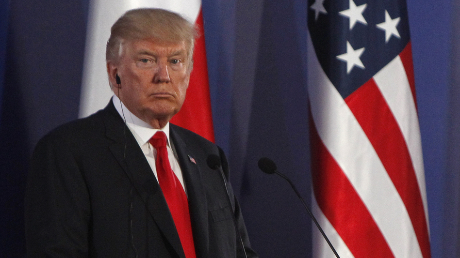 President Trump listens during a joint press conference with Poland's President Andrzej Duda, in Warsaw, Poland, on Thursday. (Czarek Sokolowski/AP)