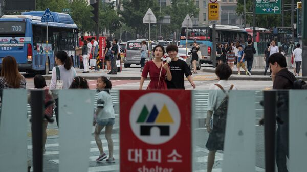 A shelter sign is displayed at the entrance to a subway station in Seoul on Wednesday, a day after North Korea tested an intercontinental ballistic missile. Subway stations are designated as shelters in case of aerial bombardment, part of the city