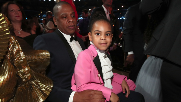 Blue Ivy Carter sits on her father, Jay-Z