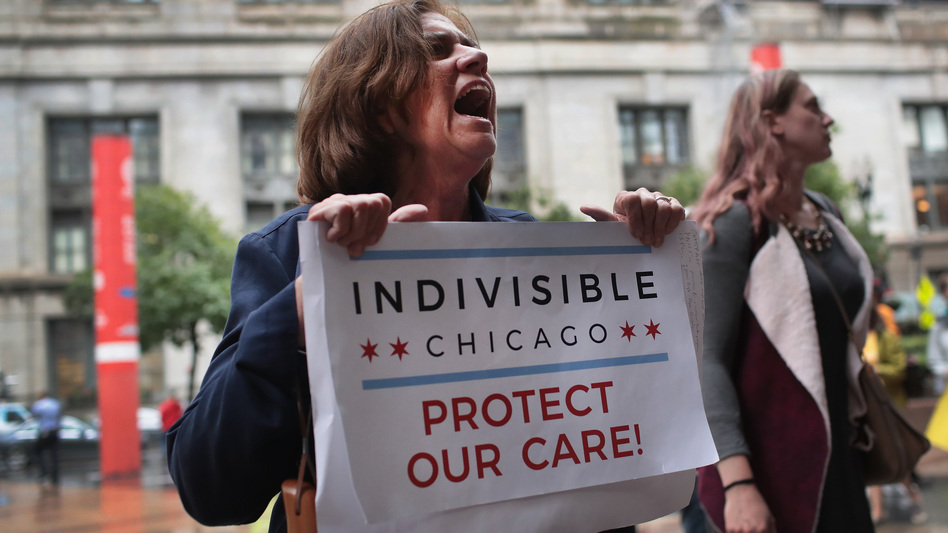 Demonstrators protest changes to the Affordable Care Act on June 28, 2017, in Chicago, Illinois. (Scott Olson/Getty Images)