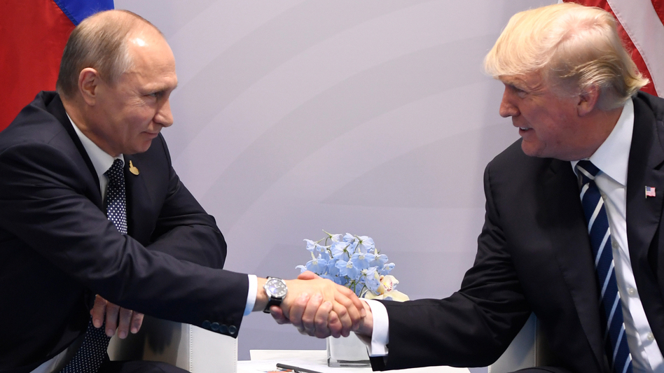 President Trump and Russian President Vladimir Putin shake hands during a meeting on the sidelines of the Group of 20 summit in Hamburg, Germany, on Friday. (Saul Loeb/AFP/Getty Images)