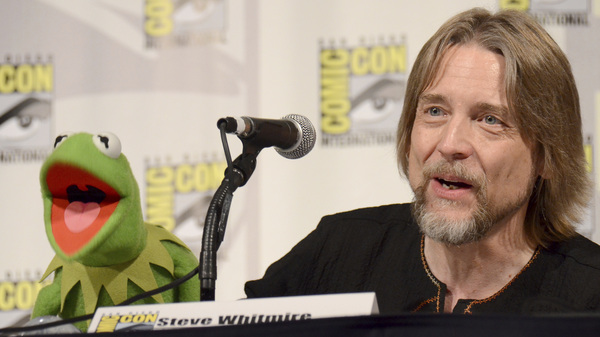 Steve Whitmire sits beside his famous colleague Kermit the Frog, the puppet he voiced for 27 years, at the 2015 Comic-Con in San Diego.
