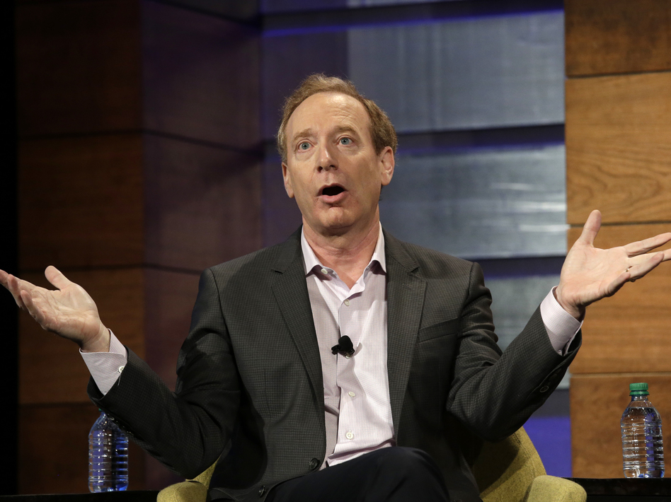 """We should be around the world. But we should also be focused on our own backyards,"" Microsoft President Brad Smith says. (Elaine Thompson/AP)"
