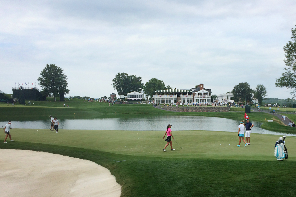 Golfers work on the 16th green during a practice round Wednesday at Trump National Golf Club in Bedminster, N.J. The U.S. Women's Open Golf Championship starts there today. (Joel Rose/NPR)