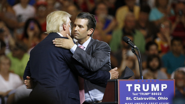Donald Trump Jr. hugs his father, Donald Trump, during a rally in Ohio weeks after Trump Jr. met with a Russian lawyer, as he sought dirt against Democrat Hillary Clinton.