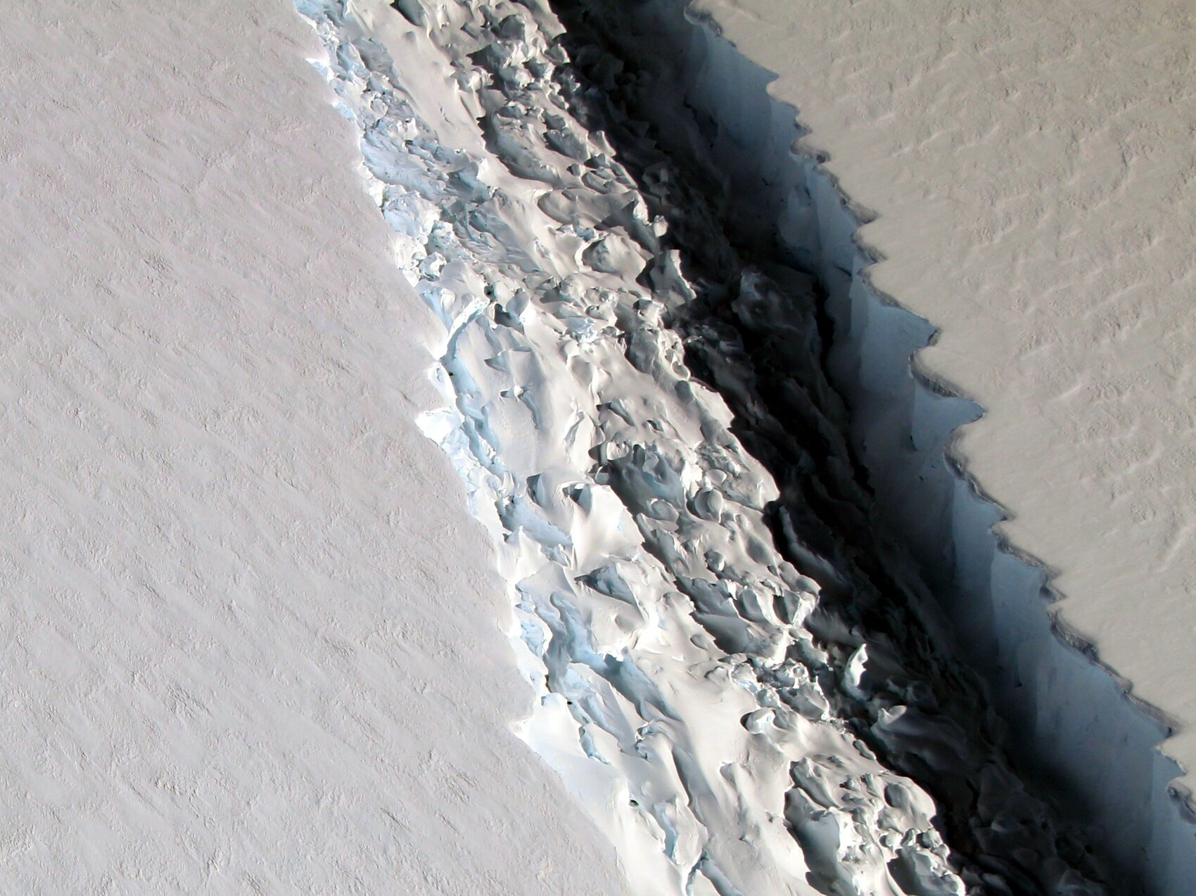 The breakup, while astounding in size, will not have an effect on global sea levels because this chunk of ice was already floating on water when it broke off, an expert says.     (John Sonntag/NASA)