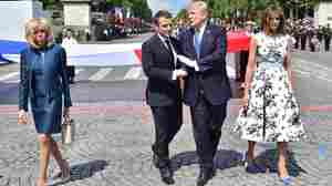 Macron's Strategy For Trump In Paris: Long Handshakes And Military Spectacles